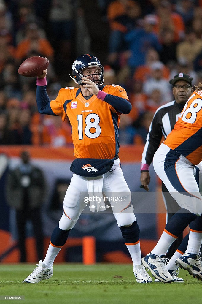 Quarterback <a gi-track='captionPersonalityLinkClicked' href=/galleries/search?phrase=Peyton+Manning&family=editorial&specificpeople=184524 ng-click='$event.stopPropagation()'>Peyton Manning</a> #18 of the Denver Broncos passes during a game against the New Orleans Saints at Sports Authority Field Field at Mile High on October 28, 2012 in Denver, Colorado.