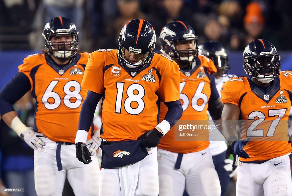 Quarterback <a gi-track='captionPersonalityLinkClicked' href=/galleries/search?phrase=Peyton+Manning&family=editorial&specificpeople=184524 ng-click='$event.stopPropagation()'>Peyton Manning</a> #18 of the Denver Broncos reacts alongside teammates guard <a gi-track='captionPersonalityLinkClicked' href=/galleries/search?phrase=Zane+Beadles&family=editorial&specificpeople=5637531 ng-click='$event.stopPropagation()'>Zane Beadles</a> #68, center Manny Ramirez #66 and running back <a gi-track='captionPersonalityLinkClicked' href=/galleries/search?phrase=Knowshon+Moreno&family=editorial&specificpeople=3986554 ng-click='$event.stopPropagation()'>Knowshon Moreno</a> #27 in the second quarter against the Seattle Seahawks during Super Bowl XLVIII at MetLife Stadium on February 2, 2014 in East Rutherford, New Jersey.