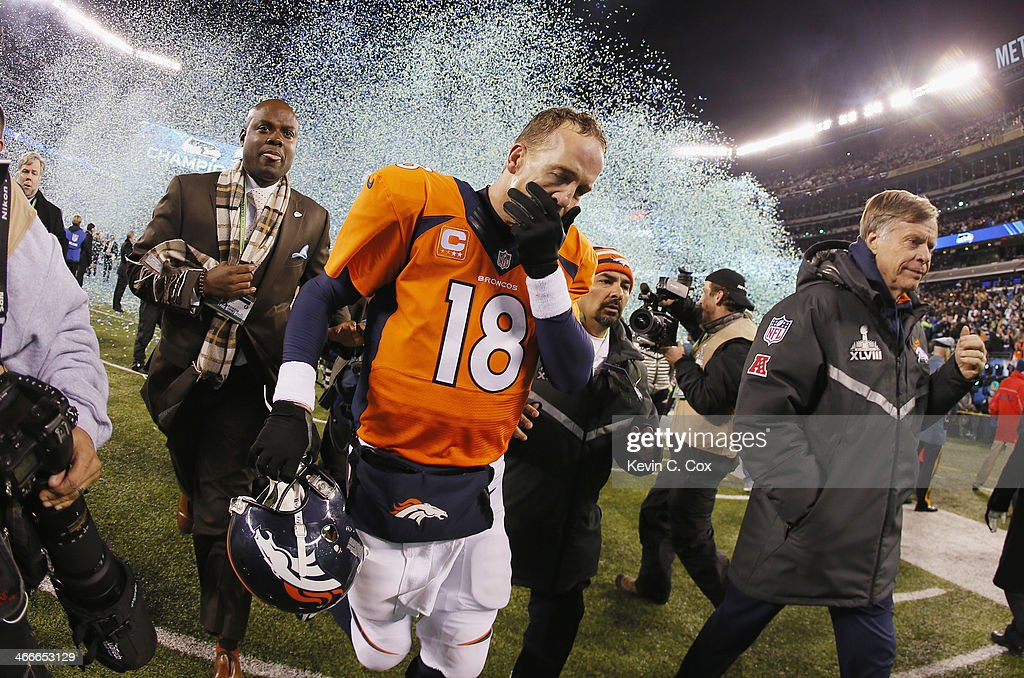Quarterback Peyton Manning #18 of the Denver Broncos reacts as he walks off the field after their 43-8 loss to the Seattle Seahawks during Super Bowl XLVIII at MetLife Stadium on February 2, 2014 in East Rutherford, New Jersey.