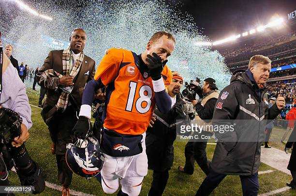 Quarterback Peyton Manning of the Denver Broncos reacts as he walks off the field after their 438 loss to the Seattle Seahawks during Super Bowl...