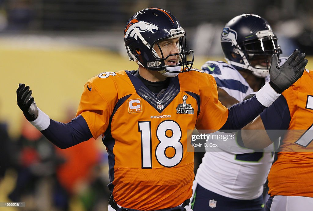 Quarterback <a gi-track='captionPersonalityLinkClicked' href=/galleries/search?phrase=Peyton+Manning&family=editorial&specificpeople=184524 ng-click='$event.stopPropagation()'>Peyton Manning</a> #18 of the Denver Broncos reacts in the fourth quarter while taking on the Seattle Seahawks during Super Bowl XLVIII at MetLife Stadium on February 2, 2014 in East Rutherford, New Jersey.
