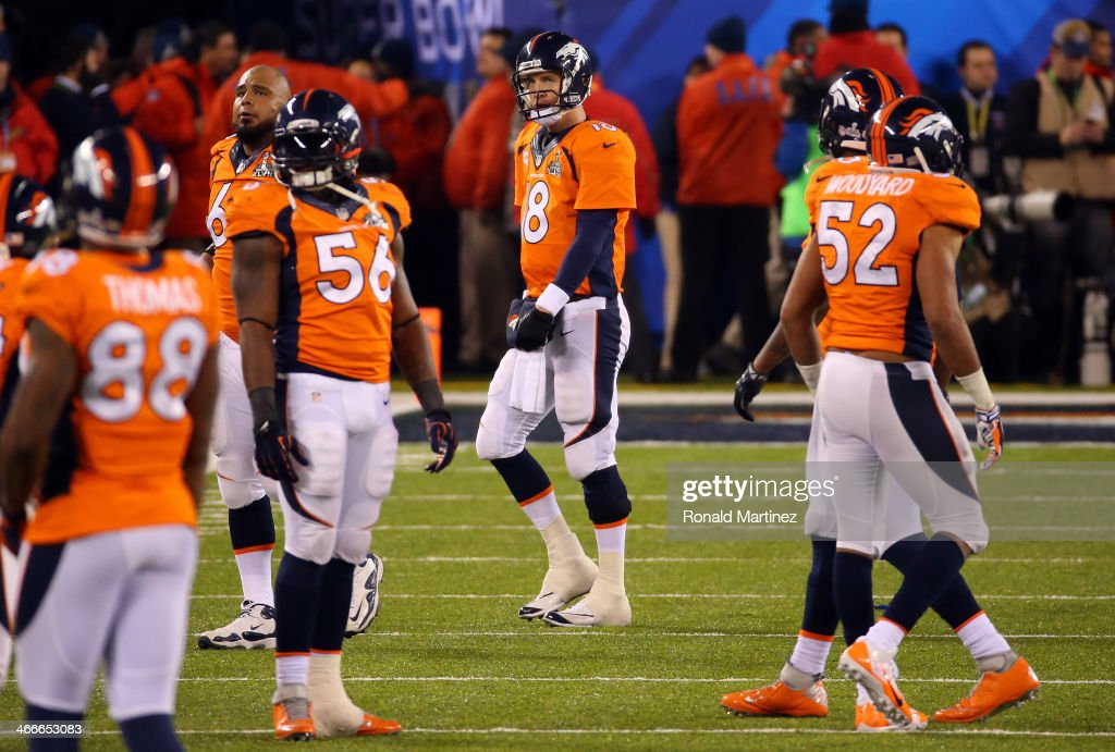 Quarterback Peyton Manning #18 of the Denver Broncos reacts in the fourth quarter against the Seattle Seahawks during Super Bowl XLVIII at MetLife Stadium on February 2, 2014 in East Rutherford, New Jersey.