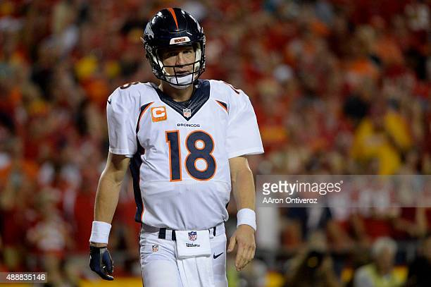 Quarterback Peyton Manning of the Denver Broncos reacts to going down as defensive end Mike DeVito of the Kansas City Chiefs recorded a sack during...