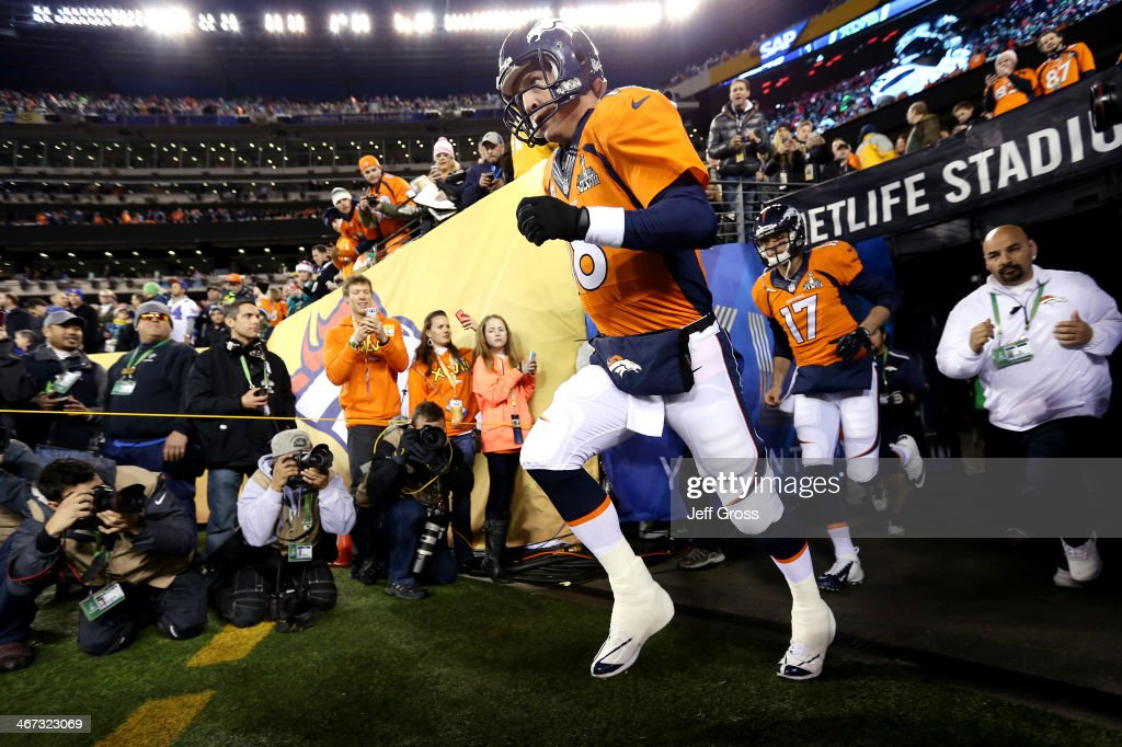 Quarterback Peyton Manning of the Denver Broncos runs onto the field before playing against the Seattle Seahawks during Super Bowl XLVIII at MetLife...