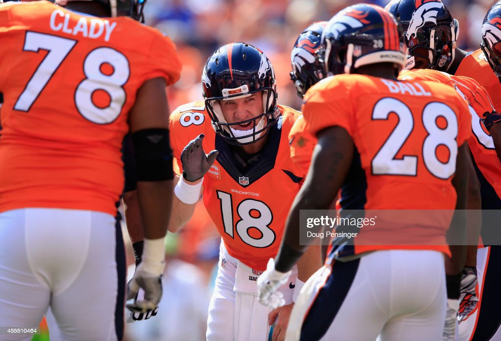 Quarterback Peyton Manning of the Denver Broncos runs the offensive huddle as the Broncos defeated the Kansas City Chiefs 2417 at Sports Authority...