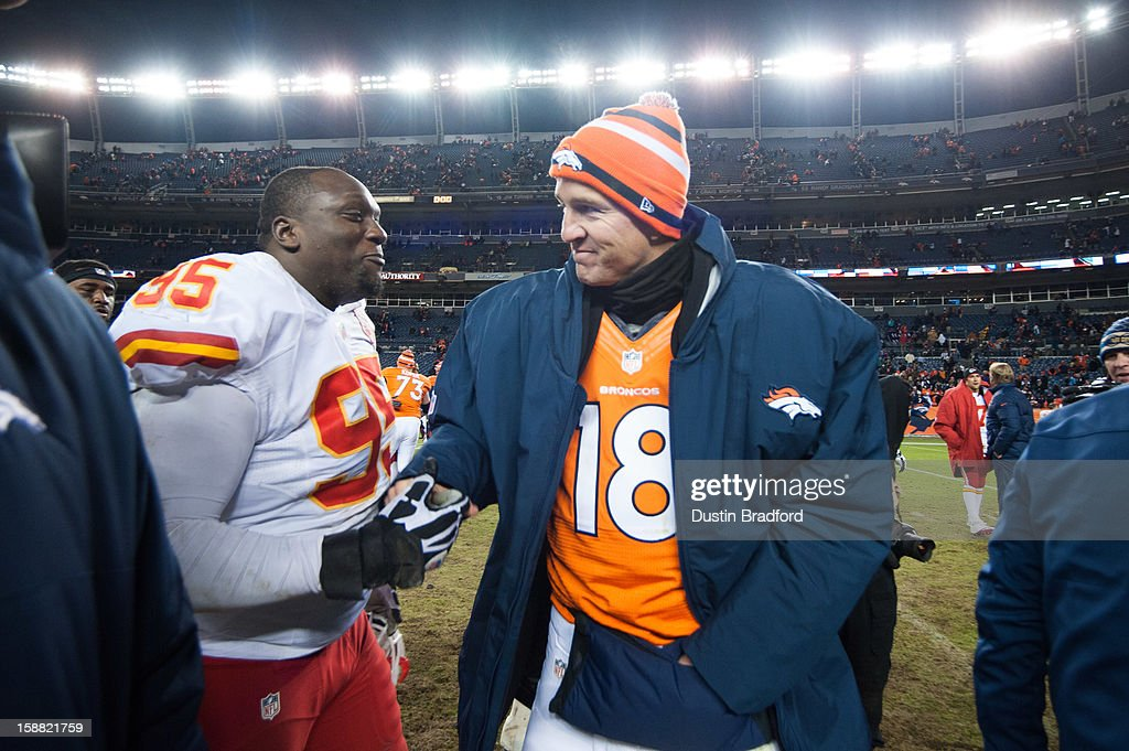 Quarterback Peyton Manning #18 of the Denver Broncos shakes hands with nose tackle Jerrell Powe #95 of the Kansas City Chiefs after a game at Sports Authority Field Field at Mile High on December 30, 2012 in Denver, Colorado. The Broncos defeated the Chiefs 38-3.