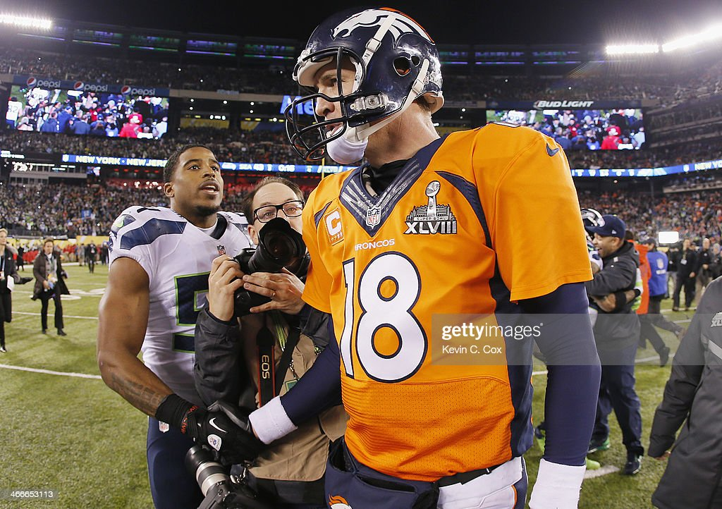 Quarterback Peyton Manning #18 of the Denver Broncos shakes hands with middle linebacker Bobby Wagner #54 of the Seattle Seahawks after their 43-8 loss during Super Bowl XLVIII at MetLife Stadium on February 2, 2014 in East Rutherford, New Jersey.