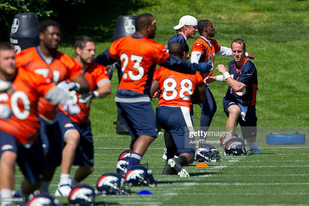 Quarterback Peyton Manning #18 of the Denver Broncos stretches with the team during organized team activities at Dove Valley on May 21, 2012 in Englewood, Colorado.