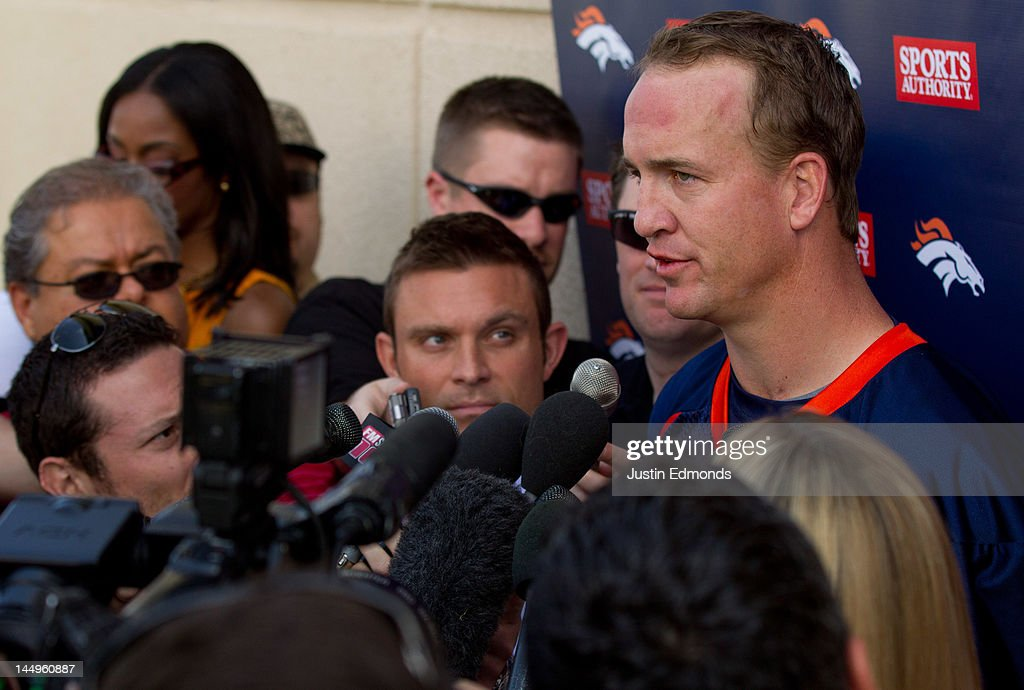 Quarterback Peyton Manning #18 of the Denver Broncos talks to the local and national media following organized team activities at Dove Valley on May 21, 2012 in Englewood, Colorado.
