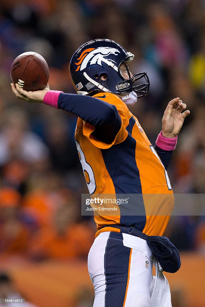 Quarterback <a gi-track='captionPersonalityLinkClicked' href=/galleries/search?phrase=Peyton+Manning&family=editorial&specificpeople=184524 ng-click='$event.stopPropagation()'>Peyton Manning</a> #18 of the Denver Broncos throws the ball against the New Orleans Saints at Sports Authority Field Field at Mile High on October 28, 2012 in Denver, Colorado. The Broncos defeated the Saints 34-14.