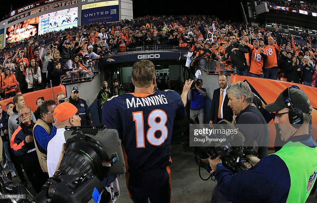 Quarterback <a gi-track='captionPersonalityLinkClicked' href=/galleries/search?phrase=Peyton+Manning&family=editorial&specificpeople=184524 ng-click='$event.stopPropagation()'>Peyton Manning</a> #18 of the Denver Broncos tosses his wrist bands to the fans as he leaves the field after facing the San Diego Chargers at Sports Authority Field at Mile High on November 18, 2012 in Denver, Colorado. The Broncos defeated the Chargers 30-23.