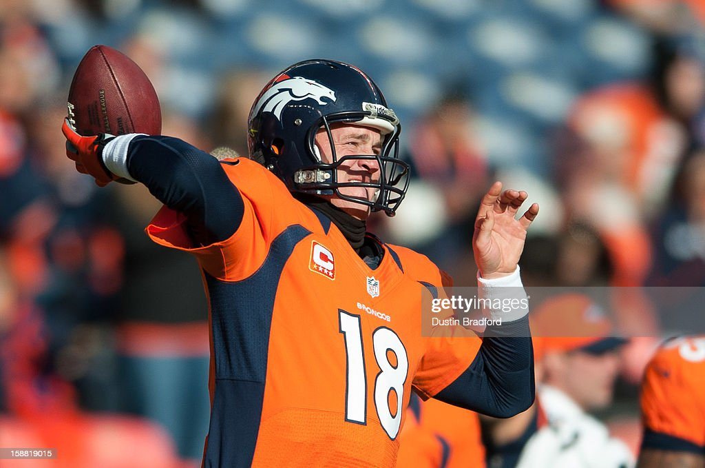 Quarterback Peyton Manning #18 of the Denver Broncos warms up before a game against the Kansas City Chiefs at Sports Authority Field Field at Mile High on December 30, 2012 in Denver, Colorado.