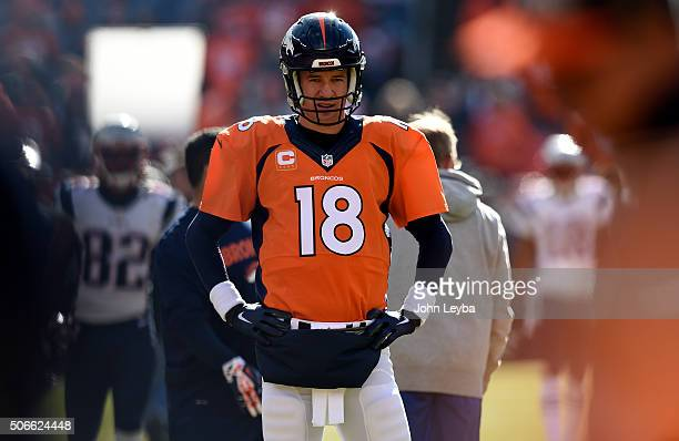 Quarterback Peyton Manning of the Denver Broncos warms up on the field prior to the start of the game The Denver Broncos played the New England...