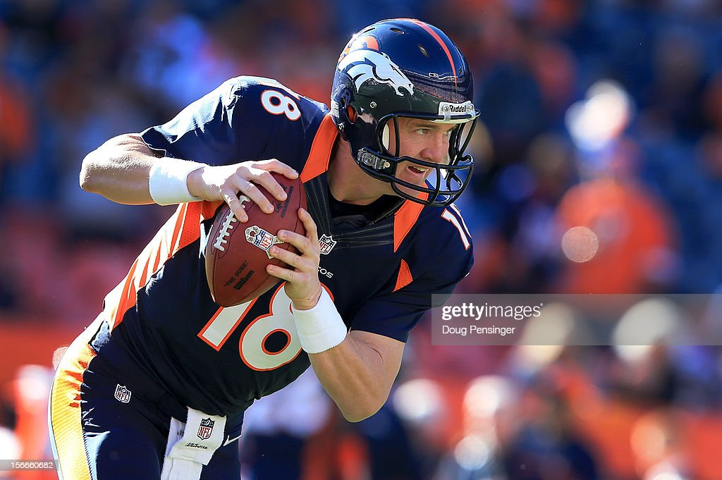 Quarterback <a gi-track='captionPersonalityLinkClicked' href=/galleries/search?phrase=Peyton+Manning&family=editorial&specificpeople=184524 ng-click='$event.stopPropagation()'>Peyton Manning</a> #18 of the Denver Broncos warms up prior to facing the San Diego Chargers at Sports Authority Field at Mile High on November 18, 2012 in Denver, Colorado.