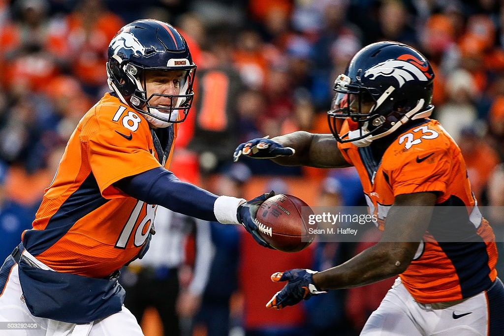 Quarterback <a gi-track='captionPersonalityLinkClicked' href=/galleries/search?phrase=Peyton+Manning&family=editorial&specificpeople=184524 ng-click='$event.stopPropagation()'>Peyton Manning</a> #18 of the Denver Broncos, who entered the game after Brock Osweiler #17 (not pictured) sustained an injury, hands off to running back <a gi-track='captionPersonalityLinkClicked' href=/galleries/search?phrase=Ronnie+Hillman&family=editorial&specificpeople=7355403 ng-click='$event.stopPropagation()'>Ronnie Hillman</a> #23 at Sports Authority Field at Mile High on January 3, 2016 in Denver, Colorado.