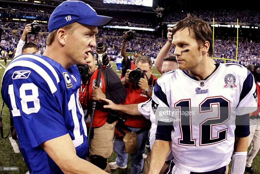 Quarterback Peyton Manning of the Indianapolis Colts greets Tom Brady of the New England Patriots after the game at Lucas Oil Stadium on November 15...