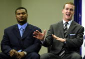 Quarterback Peyton Manning of the Indianapolis Colts sitting next to Steve McNair of the Tennessee Titans as he talks with the media after being...