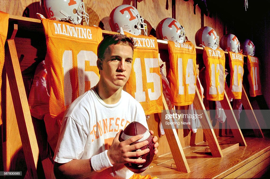 Quarterback Peyton Manning #16 of the Tennessee Volunteers poses for a portrait in the locker room circa 1995 in Knoxville, Tennessee.