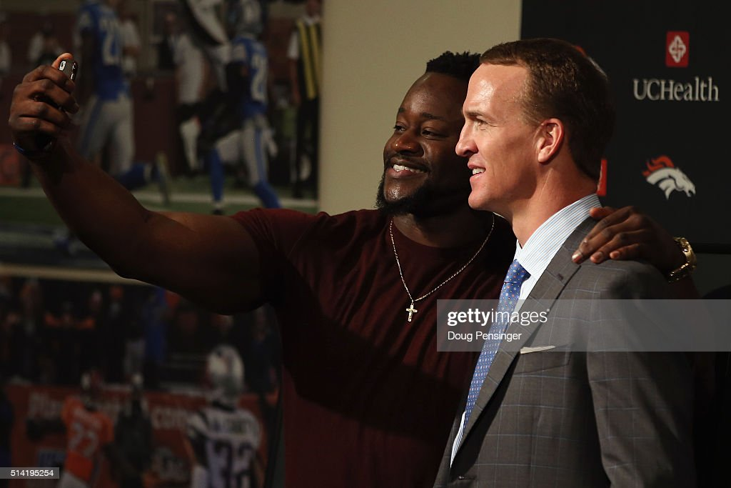 Quarterback Peyton Manning poses for a photograph with former teammate Kenny Anunike after announcing his retirement from the NFL at the UCHealth Training Center on March 7, 2016 in Englewood, Colorado. Manning, who played for both the Indianapolis Colts and Denver Broncos in a career which spanned 18 years, is the NFL's all-time leader in passing touchdowns (539), passing yards (71,940) and tied for regular season QB wins (186). Manning played his final game last month as the winning quarterback in Super Bowl 50 in which the Broncos defeated the Carolina Panthers, earning Manning his second Super Bowl title.