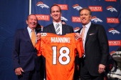 Quarterback Peyton Manning poses with majority owner president and CEO Pat Bowlen and executive vice president of football operations John Elway...