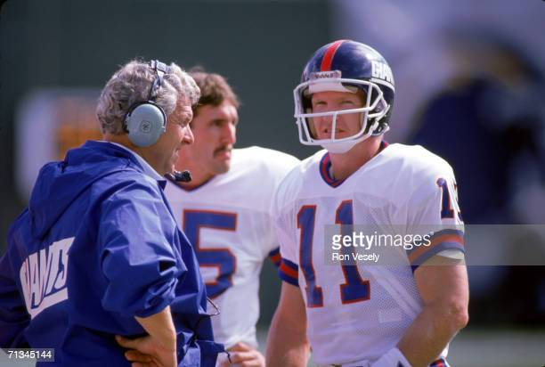 Quarterback Phil Simms of the New York Giants talks to head coach Bill Parcells during the game against the San Diego Chargers on October 22 1989 at...
