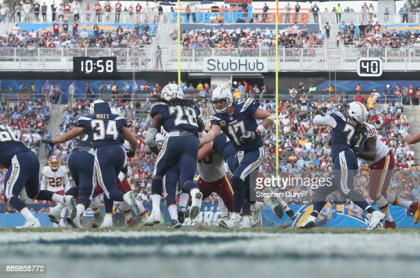 Quarterback Philip Rivers of the Los Angeles Chargers hands off to running back Melvin Gordon in the third quarter against the Washington Redskins...