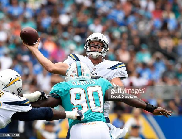 Quarterback Philip Rivers of the Los Angeles Chargers throws under pressure by defensive end Charles Harris of the Miami Dolphins during the first...