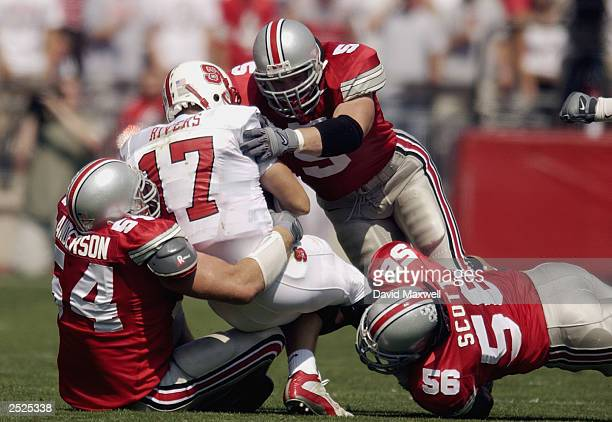 Quarterback Philip Rivers of the North Carolina State University Wolfpack is sacked by linebacker Mike D'Andrea and defensive tackle Tim Anderson of...