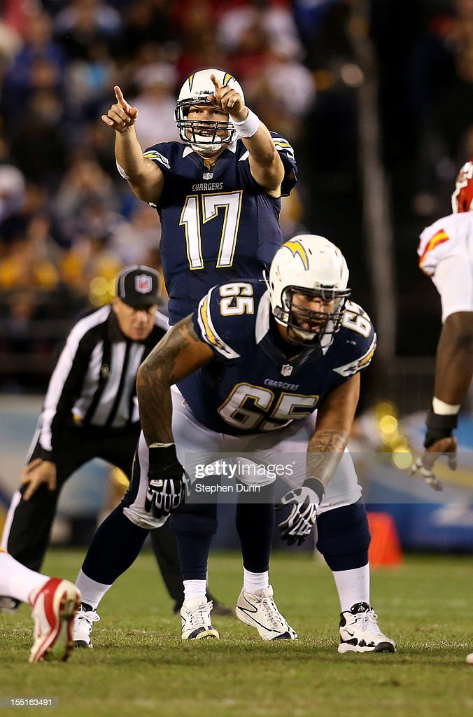 Quarterback <a gi-track='captionPersonalityLinkClicked' href=/galleries/search?phrase=Philip+Rivers&family=editorial&specificpeople=212885 ng-click='$event.stopPropagation()'>Philip Rivers</a> #17 of the San Diego Chargers calls signals behind guard Louis Vasquez #65 against the Kansas City Chiefs at Qualcomm Stadium on November 1, 2012 in San Diego, California. The Chargers won 31-13.
