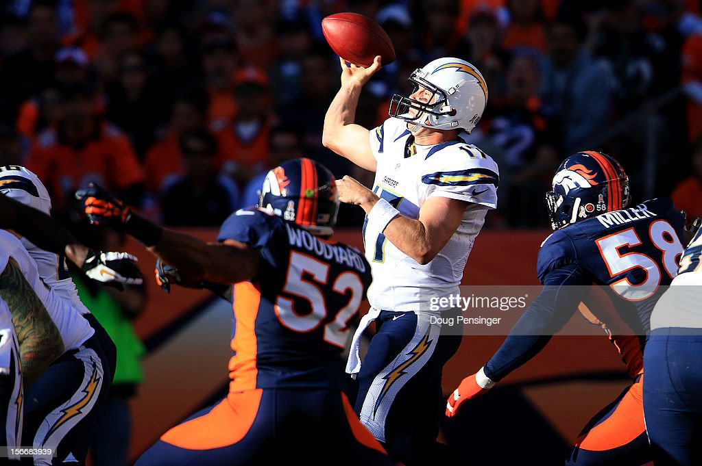 quarterback <a gi-track='captionPersonalityLinkClicked' href=/galleries/search?phrase=Philip+Rivers&family=editorial&specificpeople=212885 ng-click='$event.stopPropagation()'>Philip Rivers</a> #17 of the San Diego Chargers delivers a pass against outside linebacker Wesley Woodyard #52 and outside linebacker Von Miller #58 of the Denver Broncos at Sports Authority Field at Mile High on November 18, 2012 in Denver, Colorado. The Broncos defeated the Chargers 30-23.