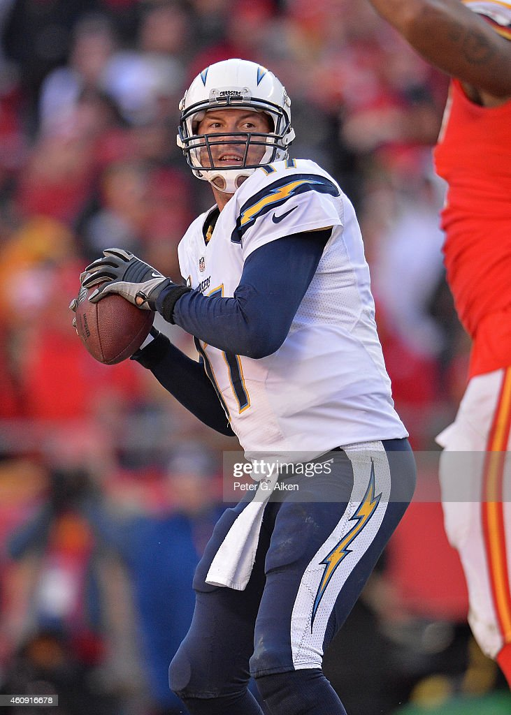 Quarterback Philip Rivers of the San Diego Chargers drops back to pass against the Kansas City Chiefs during the second half on December 28 2014 at...