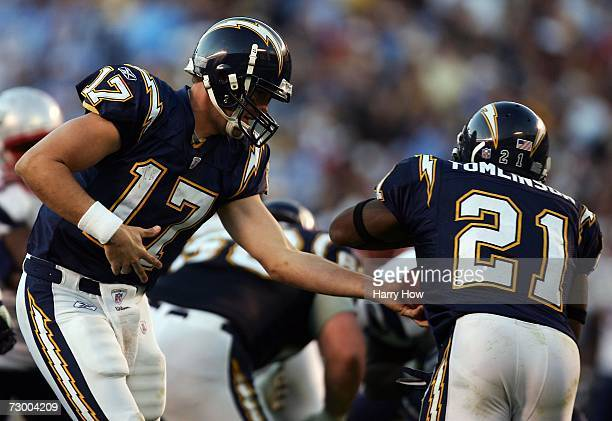 Quarterback Philip Rivers of the San Diego Chargers hands the ball off to running back LaDainian Tomlinson against the New England Patriots in the...