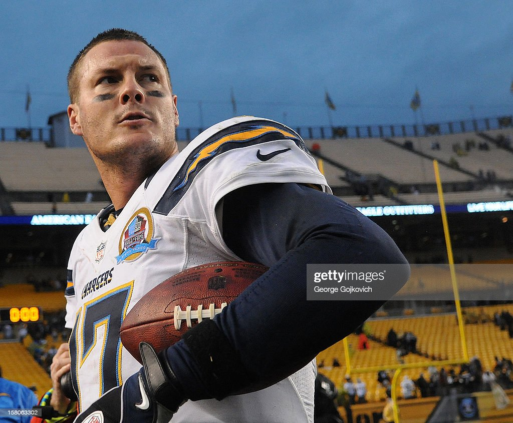 Quarterback Philip Rivers #17 of the San Diego Chargers holds a football as he looks on from the field after a game against the Pittsburgh Steelers at Heinz Field on December 9, 2012 in Pittsburgh, Pennsylvania. The Chargers defeated the Steelers 34-24.