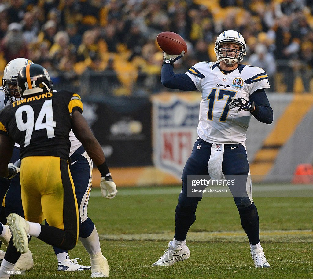 Quarterback Philip Rivers #17 of the San Diego Chargers passes as linebacker Lawrence Timmons #94 of the Pittsburgh Steelers tries to apply pressure during a game at Heinz Field on December 9, 2012 in Pittsburgh, Pennsylvania. The Chargers defeated the Steelers 34-24.