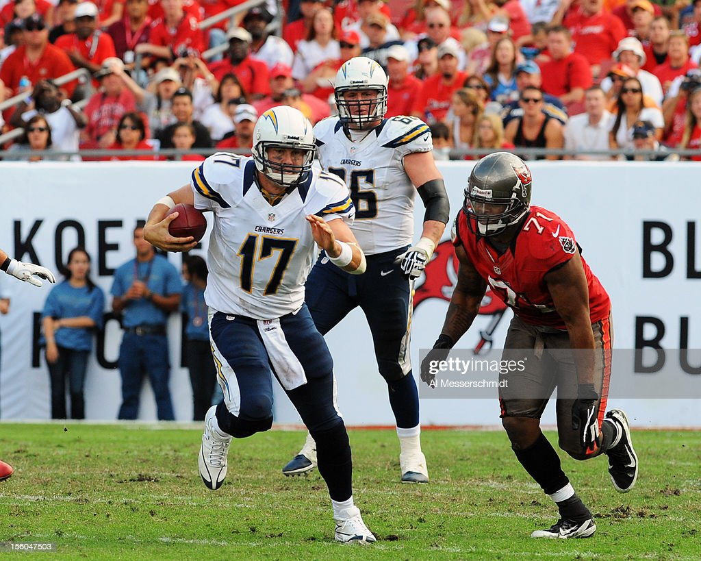 Quarterback <a gi-track='captionPersonalityLinkClicked' href=/galleries/search?phrase=Philip+Rivers&family=editorial&specificpeople=212885 ng-click='$event.stopPropagation()'>Philip Rivers</a> #17 of the San Diego Chargers runs upfield against the Tampa Bay Buccaneers November 11, 2012 at Raymond James Stadium in Tampa, Florida. Tampa won 34 - 24.