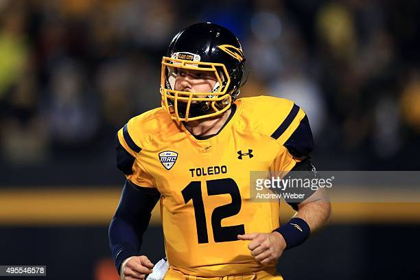Quarterback Phillip Ely of the Toledo Rockets jogs to the sidelines during the second quarter against the Northern Illinois Huskies at Glass Bowl on...
