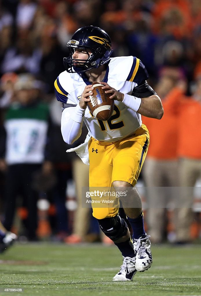 Quarterback Phillip Ely #12 of the Toledo Rockets rolls out of the pocket to pass during the fourth quarter against the Bowling Green Falcons at Doyt Perry Stadium on November 17, 2015 in Bowling Green, Ohio. Toledo defeated Bowling Green 44-28.
