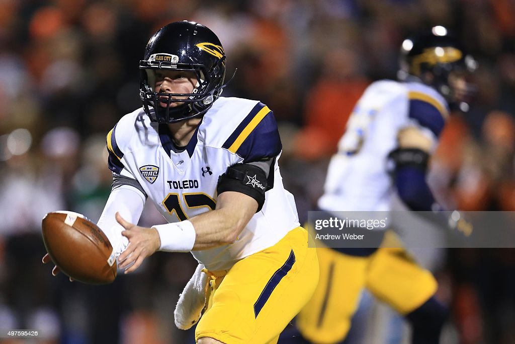 Quarterback Phillip Ely #12 of the Toledo Rockets tosses the ball during the fourth quarter against the Bowling Green Falcons at Doyt Perry Stadium on November 17, 2015 in Bowling Green, Ohio. Toledo defeated Bowling Green 44-28.