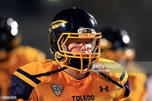 Quarterback Phillip Ely of the Toledo Rockets walks off the field after being defeated by Northern Illinois Huskies 3227 at Glass Bowl on November 3...