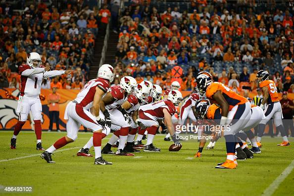 Quarterback Phillip Sims of the Arizona Cardinals runs the offense against the Denver Broncos defense during preseason action at Sports Authority...