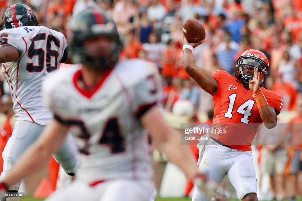 Quarterback Phillip Sims #14 of the Virginia Cavaliers throws the ball against the Richmond Spiders at Scott Stadium on September 1, 2012 in Charlottesville, Virginia.