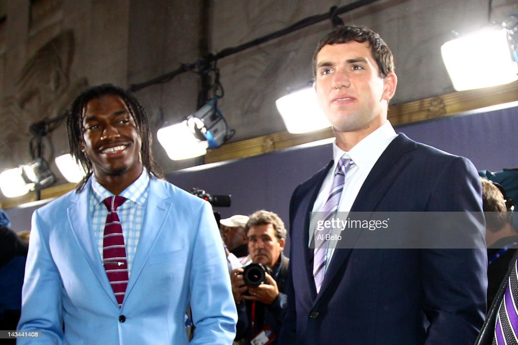 Quarterback prospects Robert Griffin III from Baylor and Andrew Luck from Stanford arrive on the red carpet during the 2012 NFL Draft at Radio City Music Hall on April 26, 2012 in New York City.