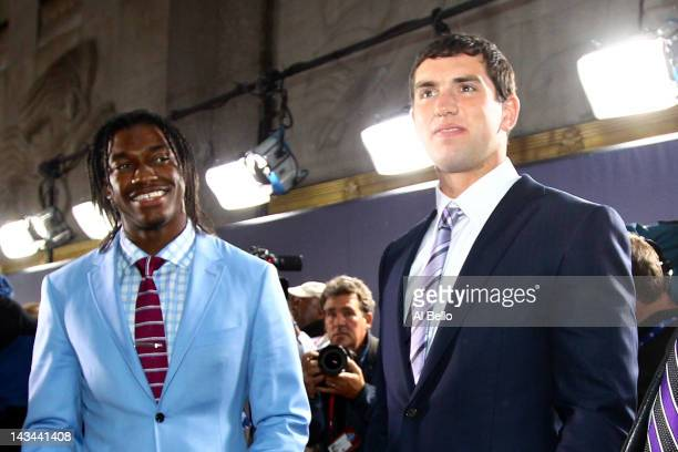 Quarterback prospects Robert Griffin III from Baylor and Andrew Luck from Stanford arrive on the red carpet during the 2012 NFL Draft at Radio City...