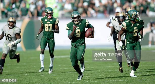 Quarterback Quinton Flowers of the South Florida Bulls runs for a touchdown against the UCF Knights during the third quarter at Raymond James Stadium...
