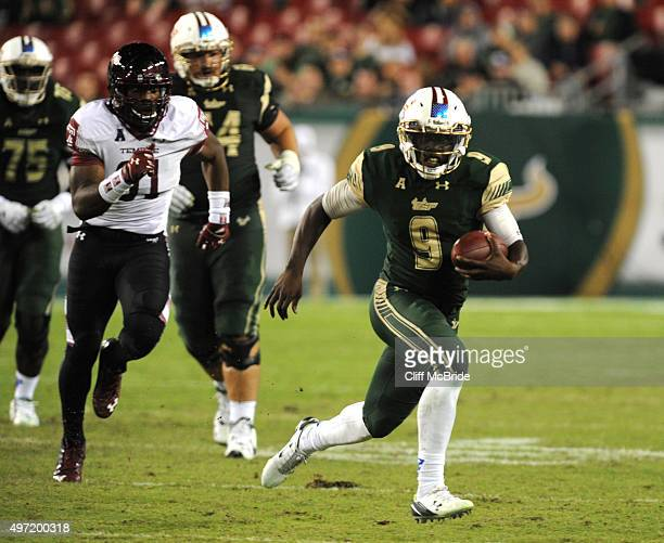 Quarterback Quinton Flowers of the South Florida Bulls runs with the ball against the Temple Owls in the third quarter at Raymond James Stadium on...