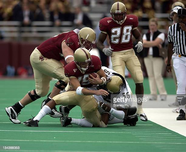 Quarterback Quinton Porter of Boston College is stopped during Pittsburgh's 2413 victory over BC at Alumni Stadium in Newton Massachusetts