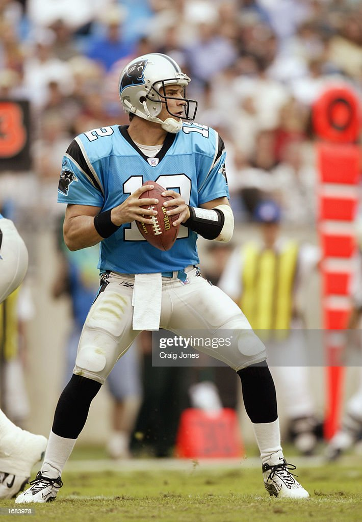 Quarterback Randy Fasani #12 of the Carolina Panthers looks for an open man against the Tampa Bay Buccaneers during the NFL game at Ericsson Stadium on October 27, 2002 in Charlotte, North Carolina. The Buccaneers won 12-9.