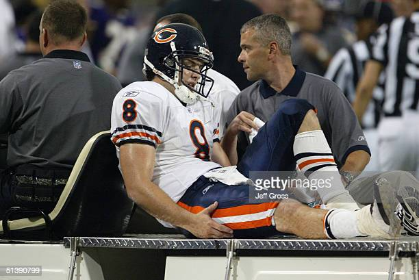 Quarterback Rex Grossman of the Chicago Bears is carted off the field injured during a game against the Minnesota Vikings at the Hubert H Humphrey...