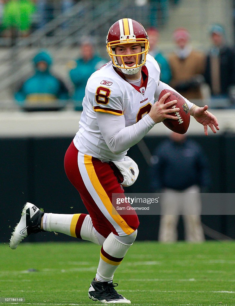 Quarterback <a gi-track='captionPersonalityLinkClicked' href=/galleries/search?phrase=Rex+Grossman&family=editorial&specificpeople=204574 ng-click='$event.stopPropagation()'>Rex Grossman</a> #8 of the Washington Redskins scrambles for yardage during the game against the Jacksonville Jaguars at EverBank Field on December 26, 2010 in Jacksonville, Florida.