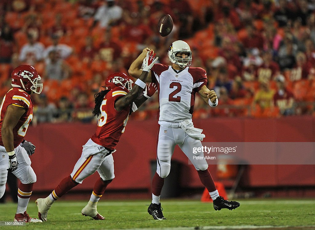 Quarterback <a gi-track='captionPersonalityLinkClicked' href=/galleries/search?phrase=Richard+Bartel&family=editorial&specificpeople=4408591 ng-click='$event.stopPropagation()'>Richard Bartel</a> #2 of the Arizona Cardinals fumbles the ball after getting hit by defensive back Dominque Ellis #45 of the Kansas City Chiefs during the second half on August 10, 2012 at Arrowhead Stadium in Kansas City, Missouri. Kansas City defeated Arizona 27-17.